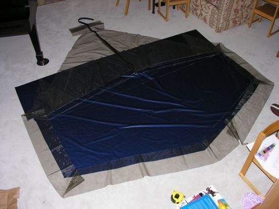 Layup of groundsheet, netting, door and zippers