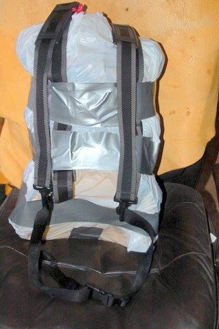 Garbage bag pack filled back side w/ harness and waist belt