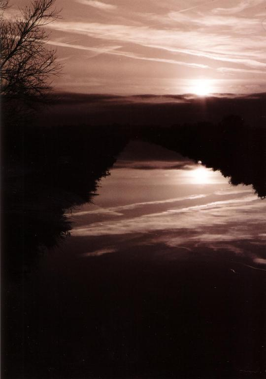 sunset over a drainage channel on the somerset levels