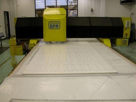 Cutting the Cuben on our CNC cutting machine