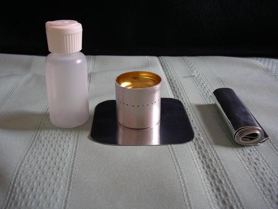 gram weenie, primer pan, windscreen, and 1 ounce fuel bottle
