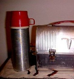 Old aluminum thermos bottle