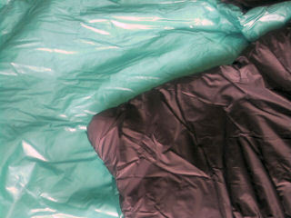 Double quilt with black Momentum taffeta inside, blue ripstop outside.