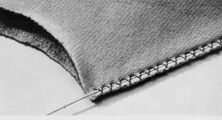 Sewing the elastic under a zigzag