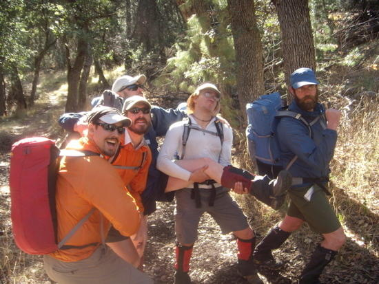 NOLS Istructors goofing off in the Mountains with light packs