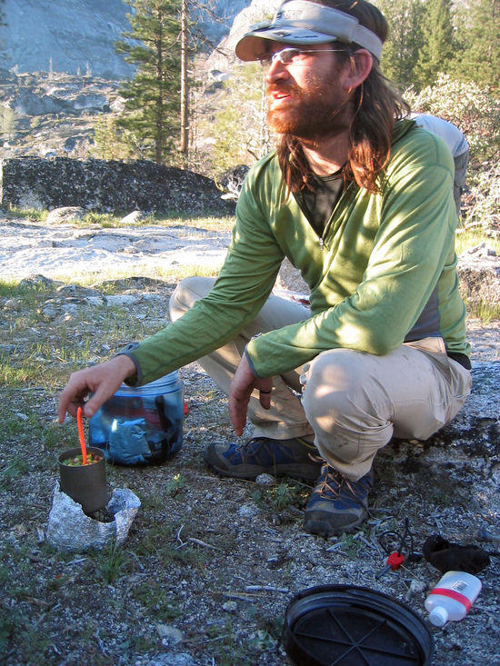 Cameron Cooking on an Alcohol Stove