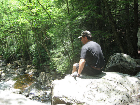 Rick hanging out along a small waterfall