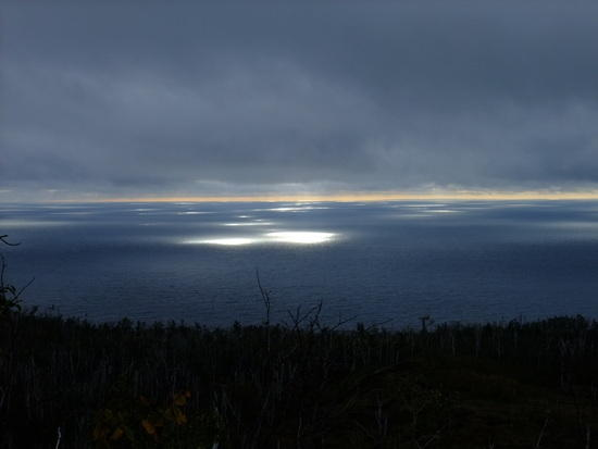 sun coming through clouds on lake superior