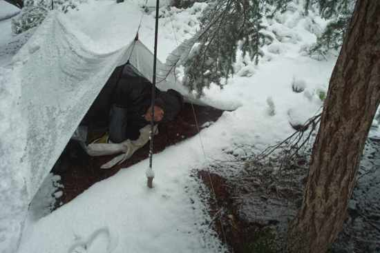 Me in the snow with tarp and nettent