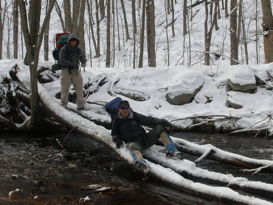 Ron & Loc carefully sliding down the last creek crossing