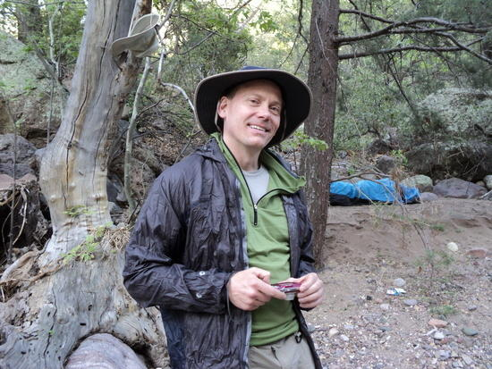 Tom at our Fish Creek campsite with bivy perched on a soft, sandy bank above the stream