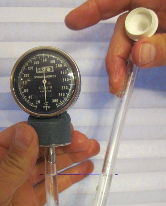 Pressure gauge at zero, water levels even