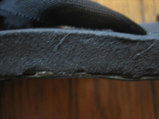 Rubber sole on right sandal