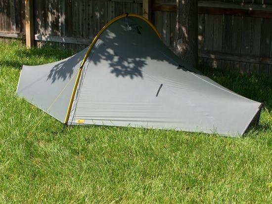 Tarptent Moment tent with yellow guy line attached to black loop on yellow pole sleeve