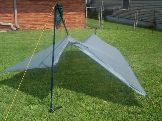 Silnylon tarp pitched with beak zipper open and beak rolled back