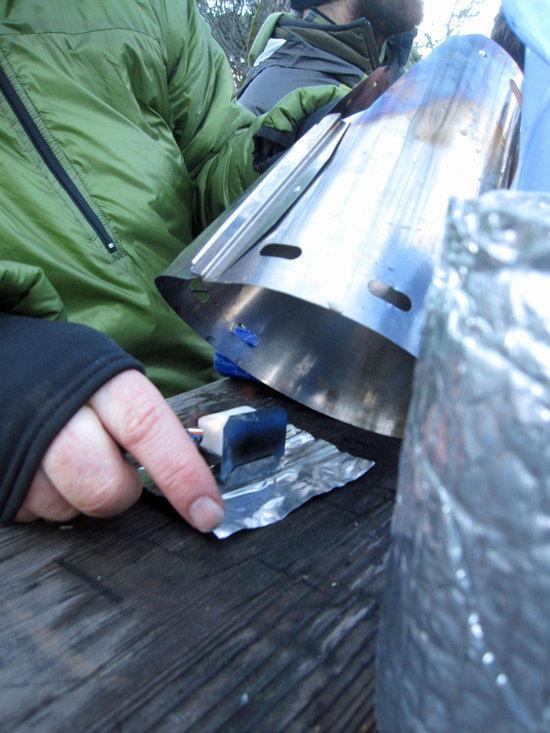 Doug Lighting Up Esbit Tablet in a Gram Cracker Stove