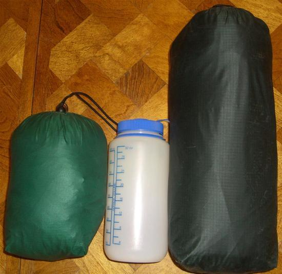 Tent and tarp in stuff sacks next to Nalgene bottle