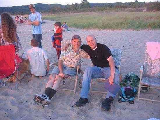 Noah (Black Shirt, Seated) next to his dad Michael Pippin.