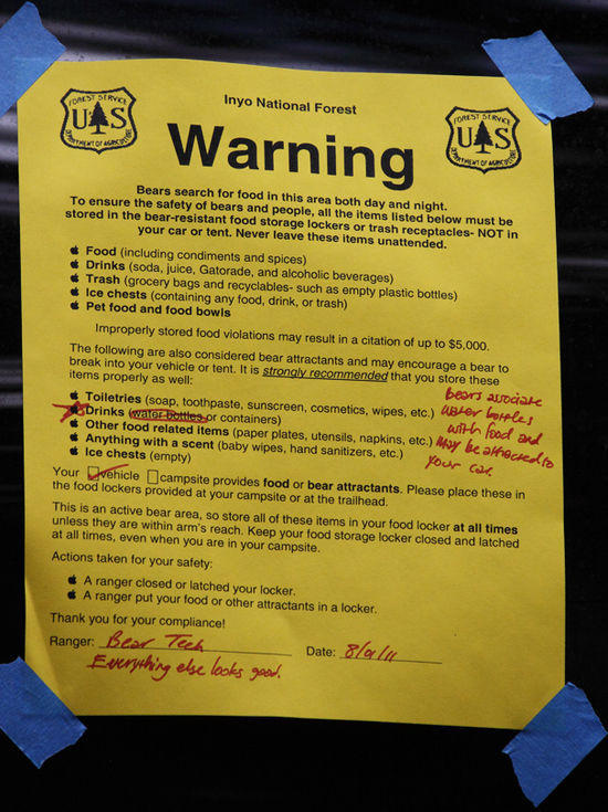 warning stuck to a car