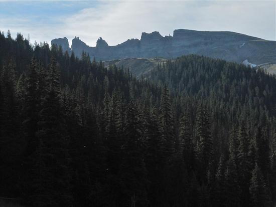 "The soft sedimentary rock of the Rio Grande basin forms a ""window"" on the ridge"