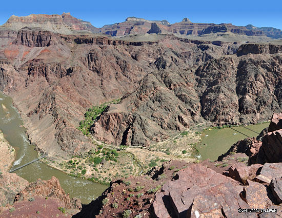 From a lookout point, a nice view of the bend where green Bright Angel canyon joins the Colorado River.