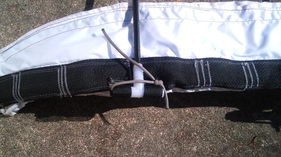 A close-up of the frame attachment point at the waist belt.