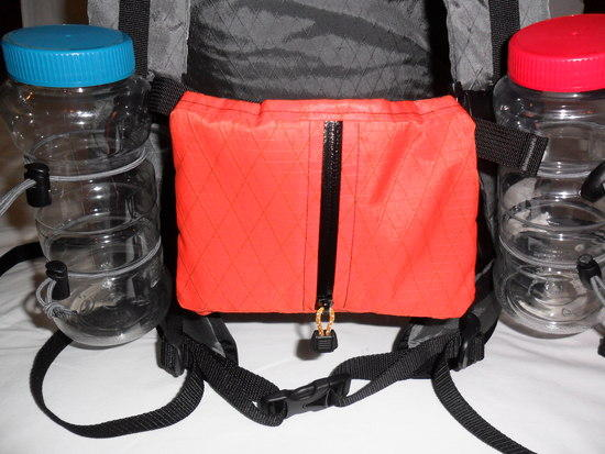 Water bottle carriers and cell phone/camera sternum strap pocket