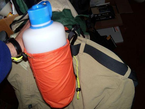 on pants belt, holding 1 liter nalgene (too heavy for my taste for a 1 inch belt, but does work)