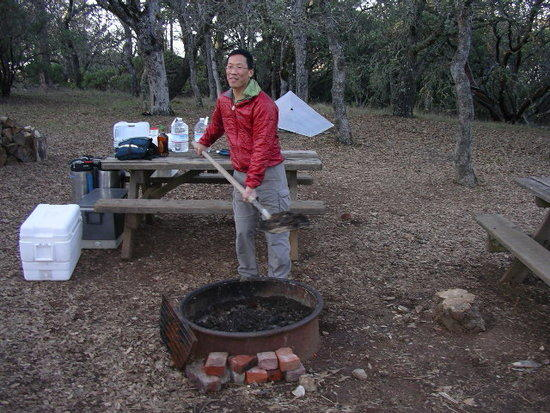 Tony Wong readies the fire pit