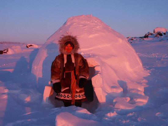 Iglu and Inuit woman - Taloyoak,Nunavut, Canada