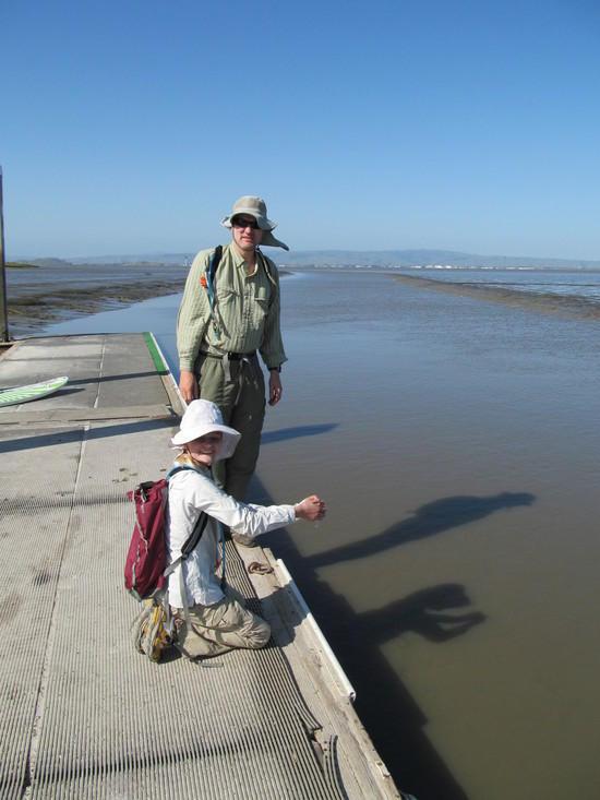 Hannah fills vial with water from San Francisco Bay