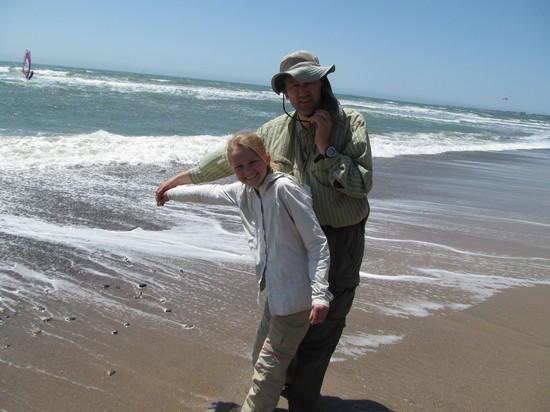 Hannah empties vial with Bay water in Pacific Ocean