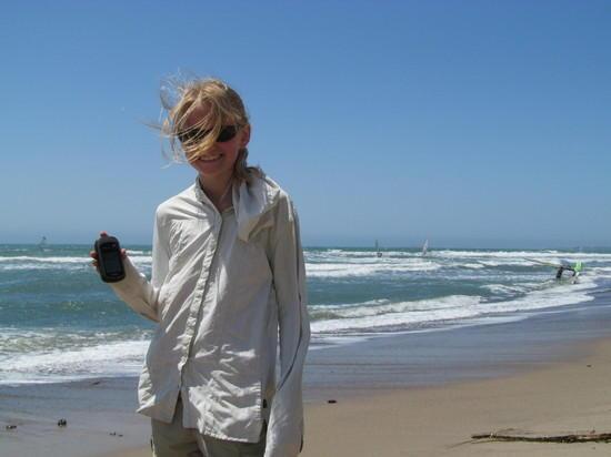 Hannah shows GPS at beach