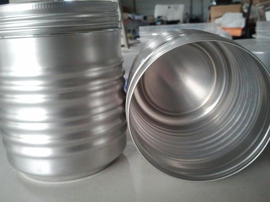 Closeup of  screw on , aluminum threaded throat and aluminum lid..