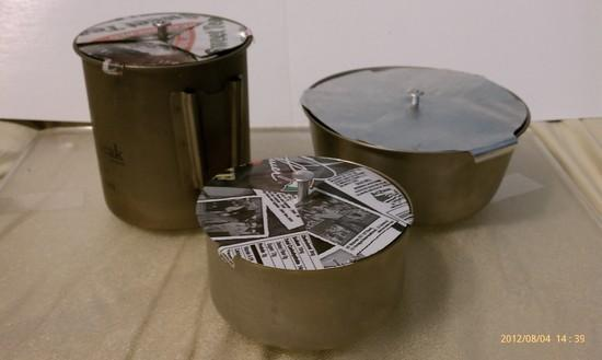 Family of pots with folding lids.
