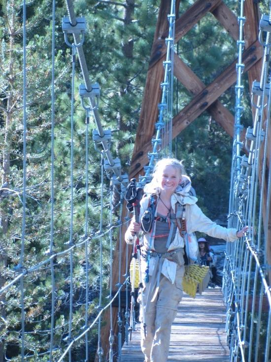 Hannah going over hanging bridge