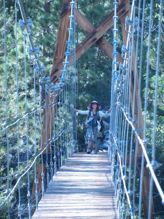 Natalie crossing hanging bridge