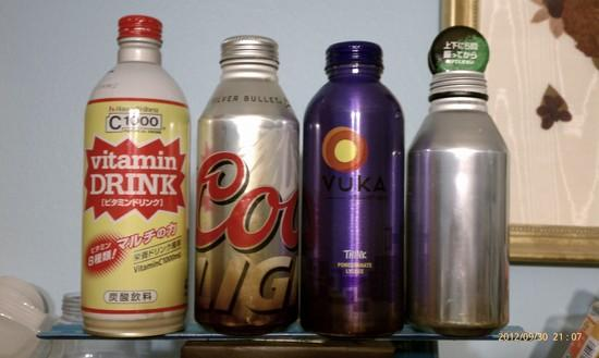 Four bottles: Vitamin C, Coors Light, Vuka Energy, Green Tea Beverage