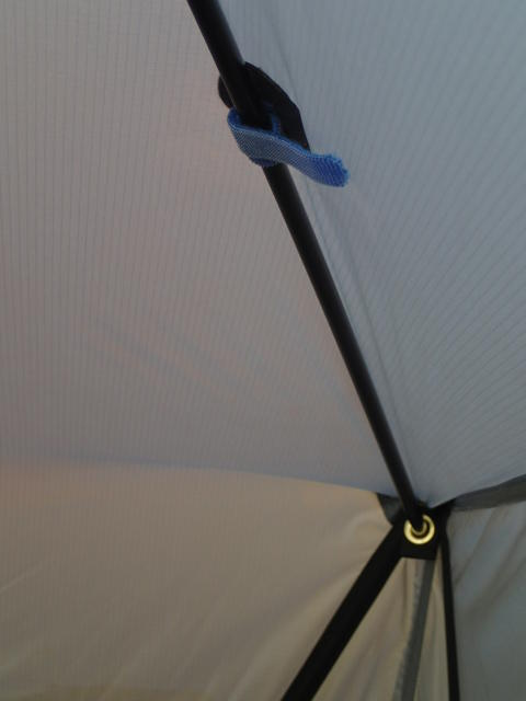 Detail of X-ing pole in corner grommet W/ Velcro cable wrap. Note the CF corner poles provide good s