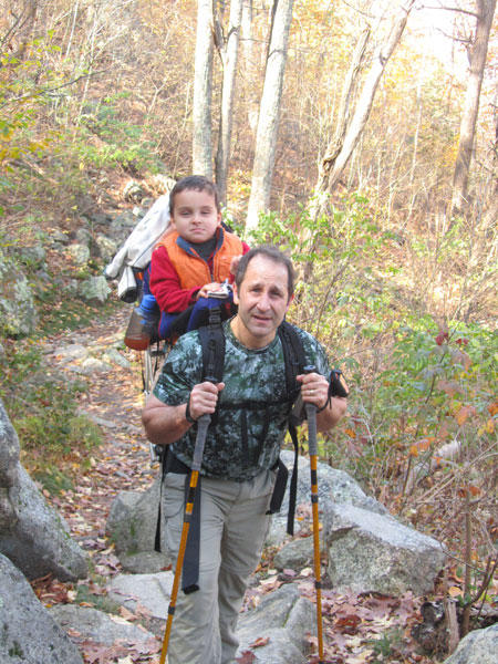 Ciro on Daddy's back climbing Old Rag with his Exped Explorer 130 SA Poles