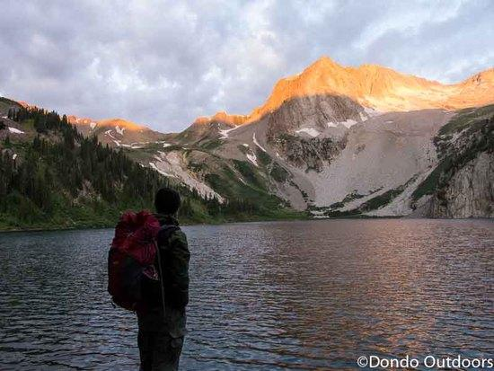 hiker-at-snowmass-lake-dawn