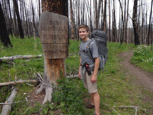 Kaleb at the Bob sign