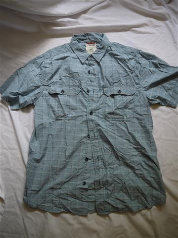 TNF Travel Shirt, medium. 15.00