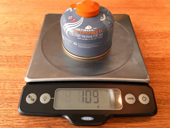 Weighing the fuel canister on a kitchen scale